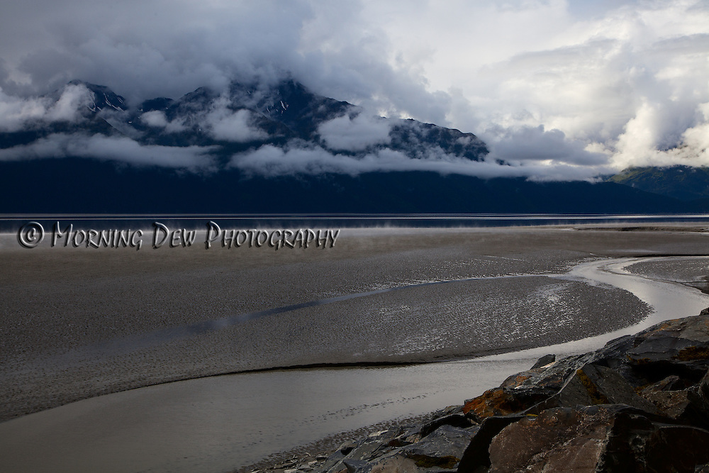 Steam rises from the glacial mud flats of Turnagain Arm after a summer rain.