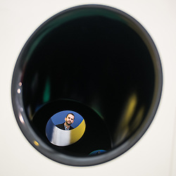 London, UK - 15 October 2014: a man looks through Carsten Holler's installation 'Gartenkinder' at the Gagosian Gallery stand during the first day of Frieze Art Fair and Frieze Masters in Regent's Park.