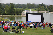 People enjoy picnic and food truck dinners on Art Hill overlooking the Grand Basin in Forest Park during St. Louis Art Museum's free Outdoor Film Series on Friday nights throughout July; St. Louis, MO