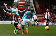 Derby County Defender Cyrus Christie gets a tackle in on Brentford midfielder Alan Judge to stop an attack during the Sky Bet Championship match between Brentford and Derby County at Griffin Park, London, England on 20 February 2016. Photo by Andy Walter.