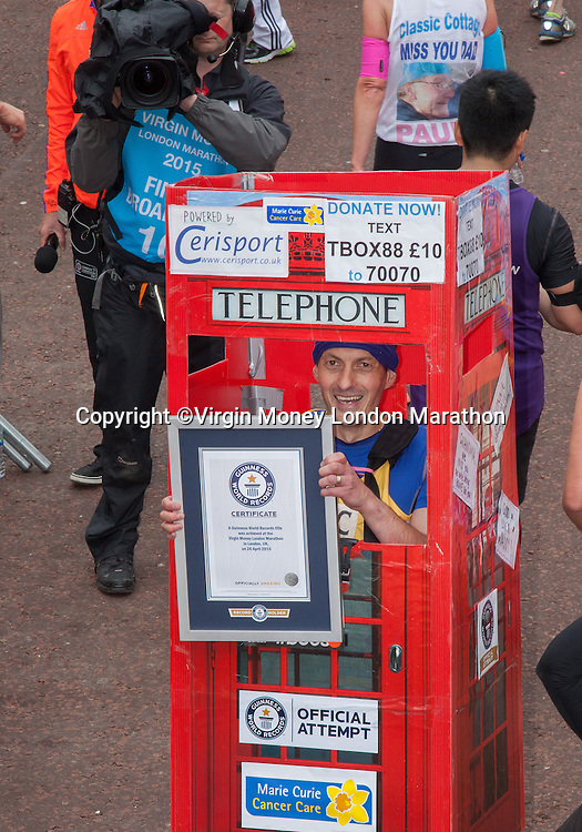 """Thomas Bolton who broke the record for the """"fastest marathon as a telephone box"""" - one of the many runners who achieved a Guinness World Record in the Virgin Money London Marathon 2015, Sunday 26th April 2015.<br /> <br /> Roger Allen for Virgin Money London Marathon<br /> <br /> For more information please contact Penny Dain at pennyd@london-marathon.co.uk"""