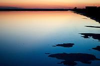 Il complesso produttivo delle saline è situato nel comune italiano di Margherita di Savoia (nome dato dagli abitanti in onore alla regina d'Italia che molto si adoperò nei confronti dei salinieri) nella provincia di Barletta-Andria-Trani in Puglia. Sono le più grandi d'Europa e le seconde nel mondo, in grado di produrre circa la metà del sale marino nazionale (500.000 di tonnellate annue).All'interno dei suoi bacini si sono insediate popolazioni di uccelli migratori e non, divenuti stanziali quali il fenicottero rosa, airone cenerino, garzetta, avocetta, cavaliere d'Italia, chiurlo, chiurlotello, fischione, volpoca..Il tramonto sulle acque di un bacino.