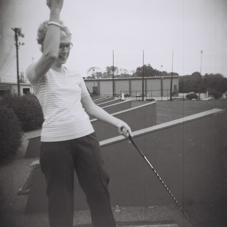 1. When was this photo taken?<br /> <br /> Early 1970s<br /> <br /> 2. Where was this photo taken?<br /> <br /> Westport, CT Golf Range<br /> <br /> 3. Who took this photo?<br /> <br /> Specifically unknown, but most likely I took it.<br /> <br /> 4. What are we looking at here?<br /> <br /> This is a photo of my mom in a moment of fun and exuberance.<br /> <br /> 5. How does this old photo make you feel?<br /> <br /> Just how much I miss my mom.<br /> <br /> 6. Is this what you expected to see?<br /> <br /> I had no idea what was on this roll of film and was very pleasantly surprised when saw this image and the others.<br /> <br /> 7. What kind of memories does this photo bring back?<br /> <br /> Just how spirited my mom was during those times, when she was presented with many of life's unplanned for challenges.<br /> <br /> 8. How do you think others will respond to this photo?<br /> <br /> I hope they will see a glimpse of my mom's soul.