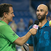 August 21, 2014, New Haven, CT:<br /> James Blake is interviewed on court by host Andrew Krasny during the Men's Legends Event on day seven of the 2014 Connecticut Open at the Yale University Tennis Center in New Haven, Connecticut Thursday, August 21, 2014.<br /> (Photo by Billie Weiss/Connecticut Open)