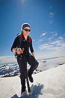 A woman climber makes her way up the Muir snow field on Mount Rainier, Washington State, USA.