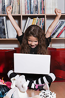 caucasian little girl computing success isolated studio