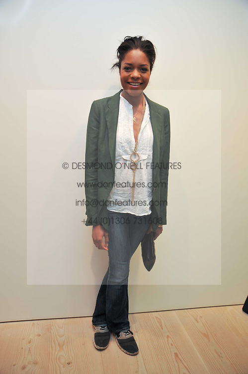 Actress NAOMIE HARRIS at an exhibition of photographic portraits by Bryan Adams entitled 'Hear The World' at The Saatchi Gallery, King's Road, London on 21st July 2009.