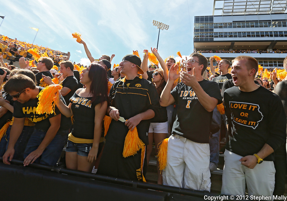 September 08 2012: Iowa Hawkeyes fans cheer before the start of the NCAA football game between the Iowa State Cyclones and the Iowa Hawkeyes at Kinnick Stadium in Iowa City, Iowa on Saturday September 8, 2012. Iowa State defeated Iowa 9-6.