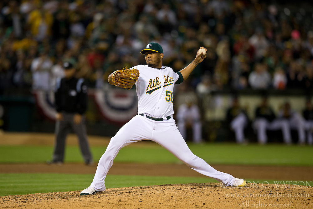 OAKLAND, CA - JULY 05:  Fernando Abad #56 of the Oakland Athletics pitches against the Toronto Blue Jays during the ninth inning at O.co Coliseum on July 5, 2014 in Oakland, California. The Oakland Athletics defeated the Toronto Blue Jays 5-1.  (Photo by Jason O. Watson/Getty Images) *** Local Caption *** Fernando Abad
