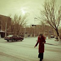 Uyghur woman cross the street in Kalamay, Xinjiang, on   February. 23, 2010. Photographer: Bernardo De Niz