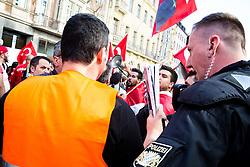 19.10.2014, Muenchen, GER, Aufmarsch von tuerkischen Nationalisten gegen die PKK, Der Rockerclub 'Turkos MC' rief zu einer Demonstration gegen die PKK auf. Laut Polizeiangaben hatte der Aufmarsch 200 Teilnehmer, weitere 50 Rocker fuhren auf Motorraedern vorneweg. Ein Grossteil der Teilnehmer trug Symboliken der nationalistischen 'Grauen Woelfe' und der MHP, viele zeigten immer wieder den sog. 'Wolfsgruss', im Bild Ein Polizist des Unterstuetzungskommandos (USK) diskutiert mit Demoteilnehmern // during a parade by Turkish nationalists against the PKK. Rockers of 'Turcos MC' called for a demonstration against the PKK. According to police, the march had 200 participants, another 50 Rocker went on motorcycles in front. A majority of the participants wore symbolism of the nationalist 'Grey Wolves' and the MHP, many showed again the so-called 'Wolf greeting', Munich, Germany on 2014/10/19. EXPA Pictures © 2014, PhotoCredit: EXPA/ Eibner-Pressefoto/ Gehrling<br /> <br /> *****ATTENTION - OUT of GER*****