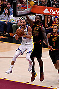 Jun 8, 2018; Cleveland, OH, USA; Golden State Warriors guard Stephen Curry (30) shoots the ball against Cleveland Cavaliers forward Jeff Green (32) during the third quarter in game four of the 2018 NBA Finals at Quicken Loans Arena.