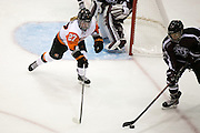 RIT's Jess Paton chases Union's Kathryn Tomaselli in the offensive zone during a game at the Gene Polisseni Center on October 3, 2014.
