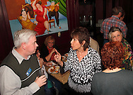 Riverside mayor Bill Flaute talks with Linda Gray of Riverside as Riverside Area Chamber of Commerce hosts an International Night featuring Indian and American food at the Filling Station Sports Bar & Grill in Riverside, Monday, March 26, 2012.  Owner Doctor Suresh Gupta prepared Indian cuisine including Bean Sprout Cucumber Salad, Butter Chicken, Samosas, Rice/Naan Bread and Veggie Khorma.