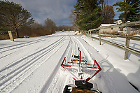 Bob Bolduc drives their new groomer tracking 10 km of cross country trails at Bolduc Park on Friday.  (Karen Bobotas/for the Laconia Daily Sun)
