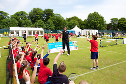 LIVERPOOL, ENGLAND - Wednesday, June 19, 2013: Local school children take part in a tennis coaching session during the Kids Day at the Liverpool Hope University International Tennis Tournament at Calderstones Park. Over 4,000 local kids take part every year. (Pic by David Rawcliffe/Propaganda)