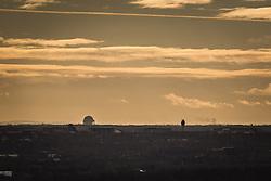 © Licensed to London News Pictures . 07/12/2013 . View south from the city centre with Jodrell Bank (left) and Manchester Airport control tower (right) . Cityscape view of Manchester . Photo credit : Joel Goodman/LNP