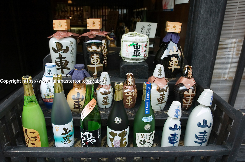 Many sake bottles outside shop in historic town of Takayama in Japan