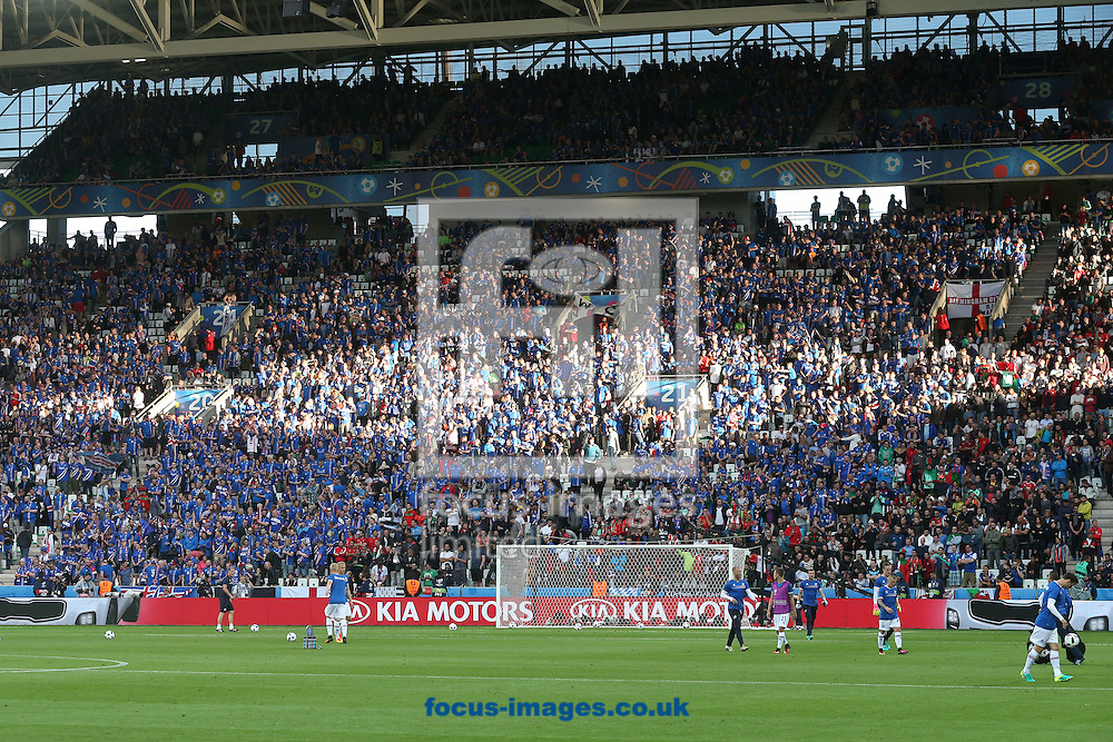 The evening sun forms a diamond on the Iceland fans before the UEFA Euro 2016 match at Stade Geoffroy-Guichard, Saint-&Eacute;tienne, France. <br /> Picture by Paul Chesterton/Focus Images Ltd +44 7904 640267<br /> 14/06/2016
