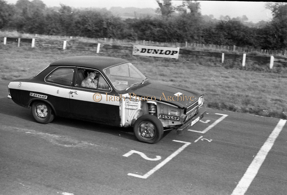 Dunlop Total Mobility Tyre At Mondello Park..1972..13.10.1972.10.13.1972..13th October 1972..A revolutionary new tyre development which can end the hazardous effects of a blowouts and punctures was announced by Dunlop.The T4 Total Mobility Tyre is designed to allow the motorist to continue for a distance of up to 100 miles at speeds of 50mph even if the tyre is deflated. The tyre is designed to enable the driver maintain control of the vehicle in the event of a blowout...Image shows the test vehicle being driven at speed around the track. Note the front wheel puncture.The wing of the car was removed to get a clear view of the tyre.