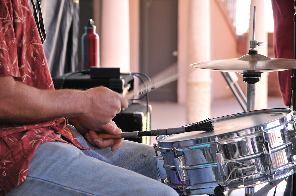 Drumming away during the Larry Armstrong & Copper Moon concert at the 2011 Tucson Folk Festival in Downtown Tucson, Arizona.