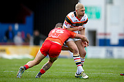 Bradford Bulls loose forward Damian Sironen (10) is tackled by Sheffield Eagles prop Kyle Trout (15)  during the Kingstone Press Championship match between Sheffield Eagles and Bradford Bulls at, The Beaumont Legal Stadium, Wakefield, United Kingdom on 3 September 2017. Photo by Simon Davies.