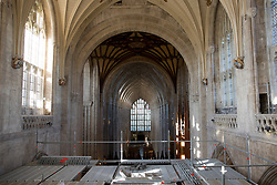 © Licensed to London News Pictures. 07/02/2018. WINCHESTER, UK. Conservators clean the Great Screen at Winchester Cathedral, Hampshire, to remove dirt and dust from the 540-year-old stonework using soft brushes and hand-held vacuum cleaners as part of a programme of urgent repairs to the Cathedral's presbytery which has been carried out over the last three years. According to Cathedral records, this will be the first time that the Great Screen has been cleaned since the 1890s. Photo credit: ISABEL INFANTES/LNP