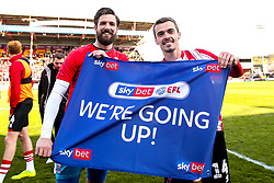 Josh Vickers and Harry Toffolo of Lincoln City celebrate winning promotion from Sky Bet League Two to Sky Bet League One - Mandatory by-line: Robbie Stephenson/JMP - 13/04/2019 - FOOTBALL - Sincil Bank Stadium - Lincoln, England - Lincoln City v Cheltenham Town - Sky Bet League Two