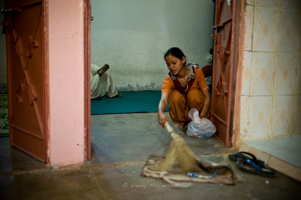 A young woman sweeps up the floor while her male family member rests in the room. <br /> Pakistan is a heavily patriarchal society with a strong feudal value system, in which women are often treated as domestic property. <br /> The United Nation's Gender Inequality Index puts Pakistan 147th in a list of 188 countries because of its poor record on women's health, education, political empowerment and economic status.