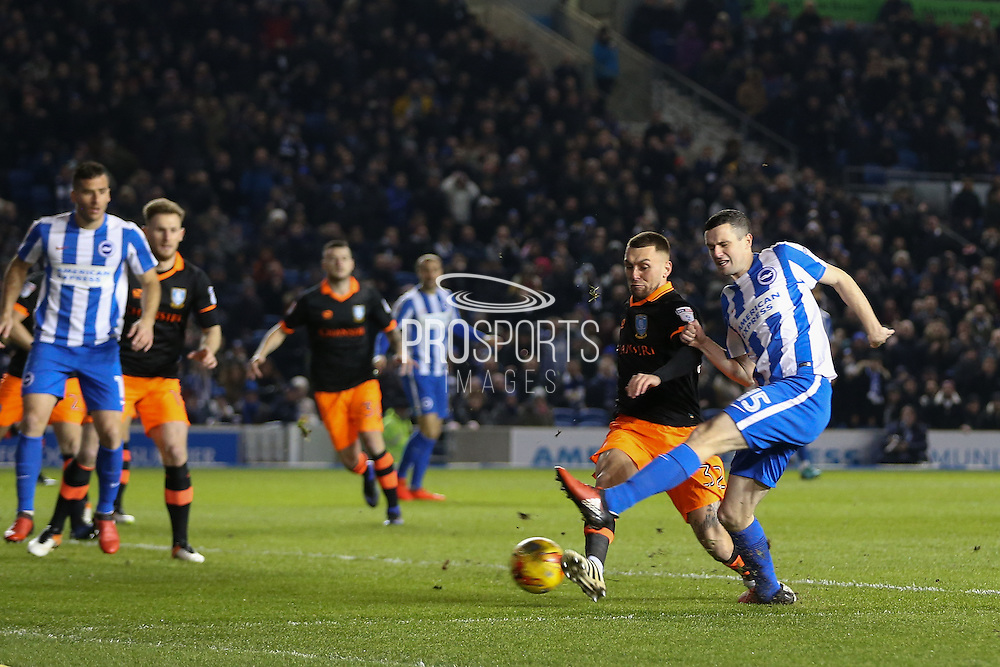 Brighton & Hove Albion winger Jamie Murphy (15) with an early shot at goal during the EFL Sky Bet Championship match between Brighton and Hove Albion and Sheffield Wednesday at the American Express Community Stadium, Brighton and Hove, England on 20 January 2017. Photo by Phil Duncan.