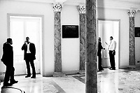 """Palermo, Italy - 20 July, 2012:  Staff of the Sicilian Regional Assembly work by President Raffaele Lombardo's office on 20 July, 2012, in Palermo, Italy.<br /> <br /> Mario Monti has expressed """"serious concerns"""" that Sicily's regional government is heading towards default and has asked its governor – who is under investigation for suspected links to the Mafia – to confirm his intention to resign. Sicily was among 23 Italian """"sub-sovereign entities"""" downgraded by Moody's rating agency on Monday, a development that has raised the possibility of a chain of defaults at the local level unless the central government intervenes. Sicily's debt was €5.3bn at the end of 2011, according to Bloomberg. Mr Monti, Italy's technocratic prime minister, indicated in his statement on Tuesday that Rome would take action to bail out Sicily's debts. Sicily has long been identified as one of the most poorly managed of Italy's regions, with the public sector accounting for the bulk of the island's economy and jobs. Commentators call it """"Italy's Greece""""."""