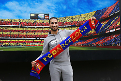 A Barcelona fan poses with a club scarf before the match - Mandatory byline: Matt McNulty/JMP - 16/03/2016 - FOOTBALL - Nou Camp - Barcelona,  - FC Barcelona v Arsenal - Champions League - Round of 16