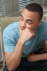 Teenage boy in hostel office.