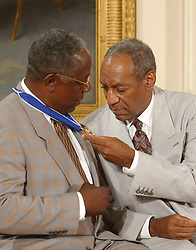 Bill Cosby admires his Presidential Medal of Freedom that he received from United States President George W. Bush during a ceremony in the East Room of the White House in Washington, D.C. on July 9, 2002..Credit: Ron Sachs / CNP. 09 Jul 2002 Pictured: Bill Cosby admires Hank Aaron's Presidential Medal of Freedom which was awarded by United States President George W. Bush during a ceremony in the East Room of the White House in Washington, D.C. on July 9, 2002..Credit: Ron Sachs / CNP. Photo credit: Ron Sachs / CNP / MEGA TheMegaAgency.com +1 888 505 6342