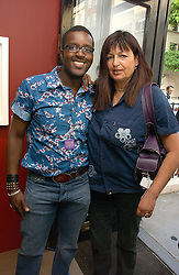 MR & MRS ORLANDO HAMILTON at a private view of artist Damian Elwes work 'Artists Studios' held at Scream, 34 Bruton Street, London W1 on 29th June 2006.<br />