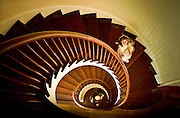 A girl plays on the stairway of a 200 year old house in New Orleans, Louisiana.