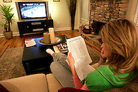 """ESPN reporter Erin Andrews at home in Dunwoody, Ga. on Thursday, Dec. 14, 2006. She says she'll often stay up until 2 a.m. reading team guides and surfing the Internet to help her prepare to report a game. Andrews will be a contestant on the television show """"Dancing With the Stars."""""""