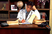 Korean medical physician intern doctor age 24 working at desk.  St Paul Minnesota USA