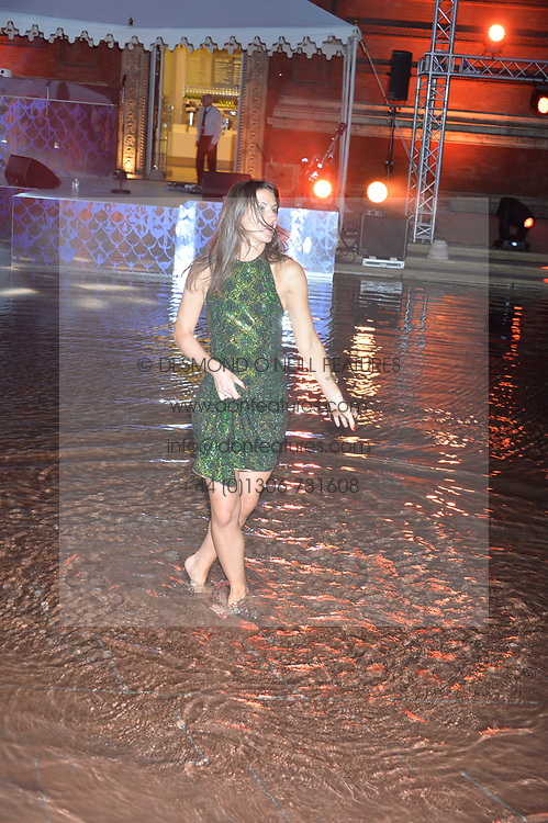 A guest dances in the pond at the V&A Summer Party 2017 held at the Victoria & Albert Museum, London England. 21 June 2017.<br /> Photo by Dominic O'Neill/SilverHub 0203 174 1069 sales@silverhubmedia.com