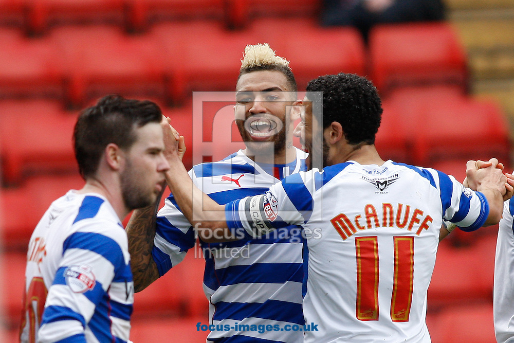 Daniel Williams of Reading (C) celebrates after scoring their first goal with Jobi McAnuff of Reading (R) during the Sky Bet Championship match at The Valley, London<br /> Picture by Andrew Tobin/Focus Images Ltd +44 7710 761829<br /> 05/04/2014