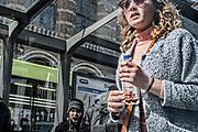Netherlands. Amsterdam, 14-04-2017. Photo: patrick Post. Passengers at Tram stop near Dam Square.