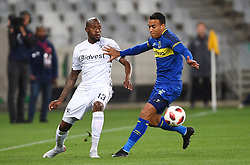 Cape Town-181002- Bidvest Wits  defender Sfiso Hlanti challenge Cape Town City's Matthew Rusike   in a PSL clash at the Cape Town stadium.Wits are fighting to get back the top spot after poor display in their last two games .Photographs:Phando Jikelo/African News Agency/ANA