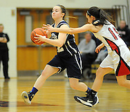 Council Rock North's Tara McGuigan #12 dribbles the ball up court as  Boyertown's Sam Brensinger #15 defends in the second quarter Saturday February 13, 2016 at Boyertown High School in Boyertown, Pennsylvania. (Photo by William Thomas Cain)