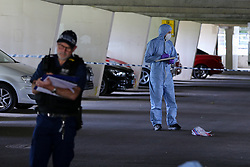 © Licensed to London News Pictures. 23/07/2020. London, UK. A forensic officer in Broadwater Farm Estate's car park, Tottenham in north London. A man is fighting for his life in hospital after a triple shooting in Tottenham, during the early hours of this morning. Police were called to shots fired on Griffin Road, where three men were found suffering from gunshot wounds. Photo credit: Dinendra Haria/LNP