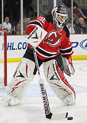 Oct 15; Newark, NJ, USA; New Jersey Devils goalie Martin Brodeur (30) plays the puck during the first period of their game against the Colorado Avalanche at the Prudential Center.