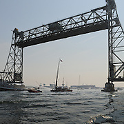 The gundalow Captain Edward H. Adams passes under the Memorial Bridge in Portsmouth, NH