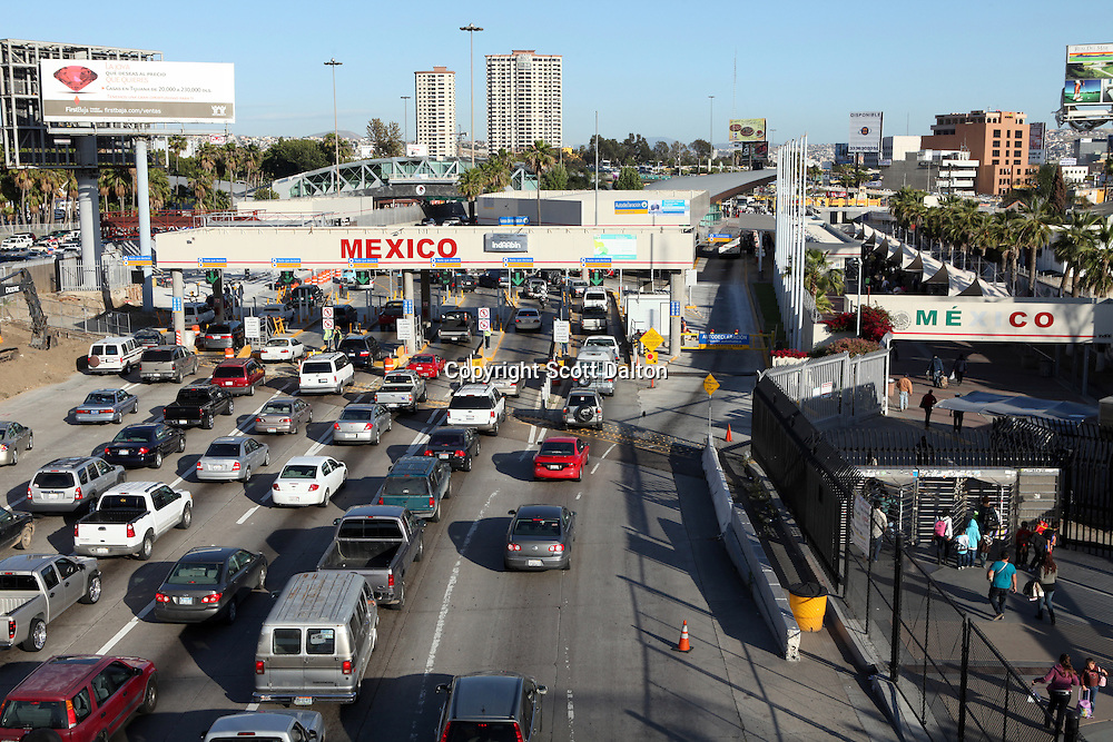 Vehicles wait to cross from San Diego, California over to Tijuana, Mexico at the San Ysidro border crossing in San Diego on April 30, 2010. The US government has stepped up inspections of vehicles crossing over to Mexico in an attempt to try to slow the flow of drug proceeds into Mexico. (Photo/Scott Dalton)