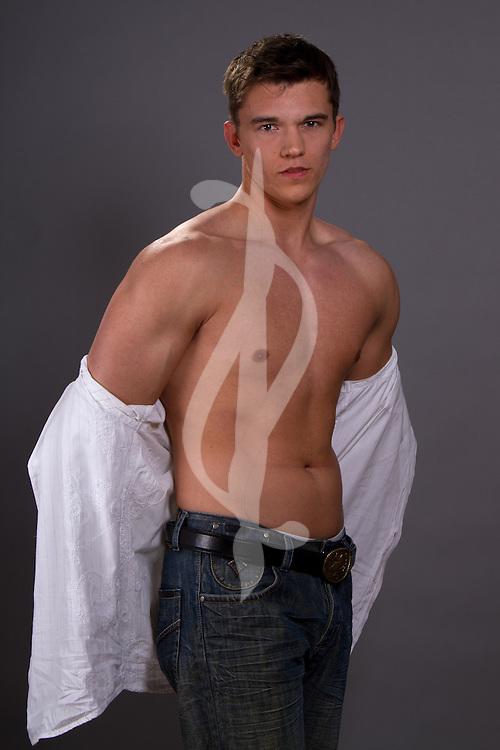 Male model posing in a modern western outfit. Contemporary Male Contemporary Male