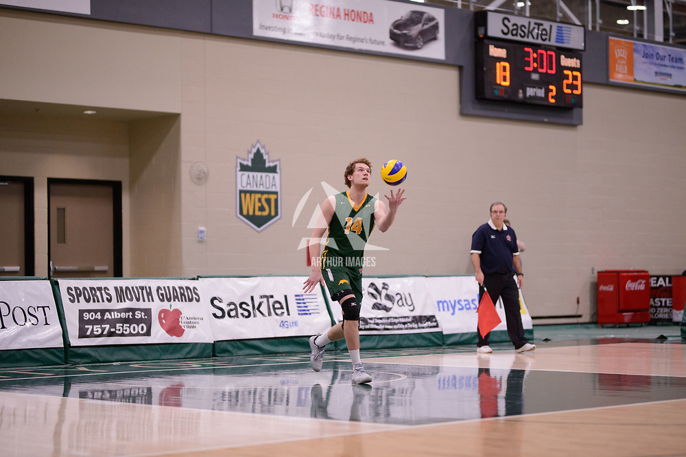 1st year middle blocker Mason Issel (14) of the Regina Cougars in action during Men's Volleyball home game on February 2 at Centre for Kinesiology, Health and Sport. Credit: Arthur Ward/Arthur Images