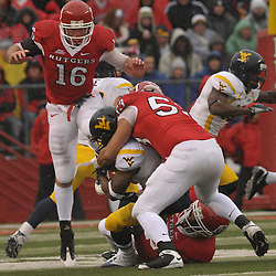 Dec 5, 2009; Piscataway, NJ, USA; West Virginia wide receiver Jock Sanders (9) is gang tackled by Rutgers offensive lineman Jamal Wilson (53), wide receiver Andrew Depaola (16) and Rutgers cornerback Khaseem Greene (20) during first half NCAA Big East college football action between Rutgers and West Virginia at Rutgers Stadium.
